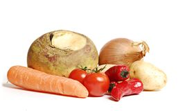 Mixed vegetables. Turnip, onion,potato,chilli,tomato, and carrot on white background Stock Photos