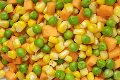 Mixed vegetables. A closeup of a plate with mixed carrots, corn and peas Royalty Free Stock Photo