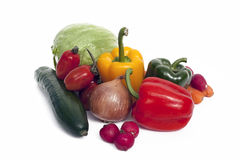 Mixed Vegetables. A view of several mixed vegetables on a white background Stock Photos