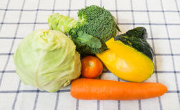 Mixed Vegetables with Broccoli and Pumpkin on Square White Backg. Mixed Vegetables with Broccoli and Yellow Pumpkin on Square White Background Royalty Free Stock Images