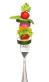 Mixed vegetables on a fork isolated. Stock Photos