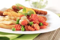 Mixed vegetables and French fries Royalty Free Stock Image