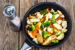 Mixed vegetables frying pan on background of old boards Stock Photography