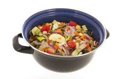 Mixed vegetables in frying pan. Mixed raw vegetables in frying pan isolated over white background Stock Photo