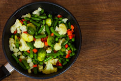 Mixed vegetables in a frying pan. on wood table with copy space. Top view royalty free stock photos