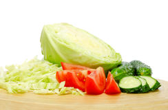 Mixed vegetables from the garden. Consisting of fresh cabbage, tomatoes and cucumbers royalty free stock image