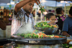 Mixed vegetables grilled by a man at Farmer`s Market Royalty Free Stock Photos