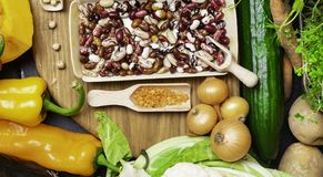 Mixed vegetables, legumes for healthy cooking. Top view. Vegan and vegetarian food. Diet eating concept. Mixed vegetables, legumes for healthy cooking on wooden stock images