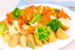 Mixed vegetables on a plate with fork Stock Photo