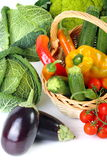 Mixed vegetables. Seasonal vegetables on white background with wicker basket Stock Photo
