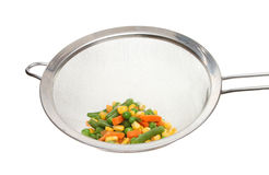Mixed vegetables in a sieve Royalty Free Stock Photography