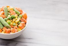 Mixed Vegetables on a White Background. Mixed Vegetables Isolated on a White Marble Background stock photo
