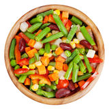 Mixed vegetables in wooden bowl isolated Royalty Free Stock Photo