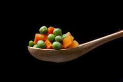 Mixed vegetables on wooden spoon. Stock Photography