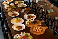 Mixed western and fusion food plates. On table stock photography