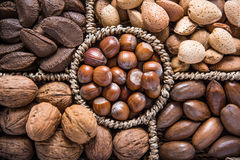 Mixed whole nuts in basket Stock Images