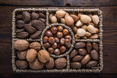 Mixed whole nuts in basket Stock Image