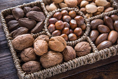 Mixed whole nuts in basket Royalty Free Stock Photos