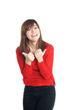 Mixed woman thumbs up in red Royalty Free Stock Photography