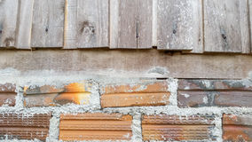 Mixed wood and bricks texture Stock Photos