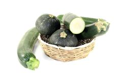 Mixed Zucchini in a basket. On a light background Royalty Free Stock Image