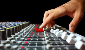 Mixer control. Hand on a mixer, operating the leader Royalty Free Stock Image