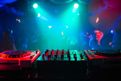 Mixer and a DJ booth in the nightclub at a party with a diffuse bright background Royalty Free Stock Images