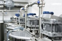 Mixer drive gearboxes mounted on metal tanks. royalty free stock photo