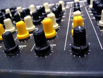 Mixer Knobs. This is a macro shot of a studio mixing board showing a close up of the tuning knobs Royalty Free Stock Photo