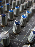 Mixer Knobs. The knobs on a sound mixer in a studio Royalty Free Stock Photos
