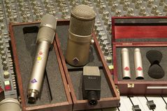 Mixer and microphone. Professional metal microphone with mixer and other studio  musical equipments Stock Photography