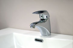 Mixer polished metal sink Royalty Free Stock Images