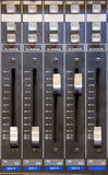 Mixer - Radio equipment. Details of audio cursors of a mixer Stock Photography