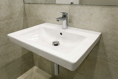 Mixer and sink in a modern bathroom. One mixer and sink in a modern bathroom Royalty Free Stock Photography