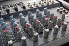 Mixer table. With several knobs stock illustration