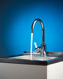Mixer tap with flowing water Royalty Free Stock Photography