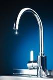 Mixer tap with water drop Stock Photos