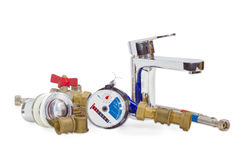 Mixer tap, water meter and some plumbing components Stock Photography