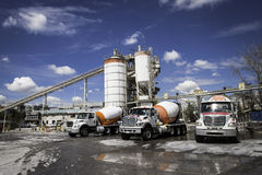 Mixer trucks in a concrete company Royalty Free Stock Images