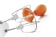Mixer and two eggs royalty free stock photo