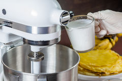 Mixer with whipping cream Stock Photography