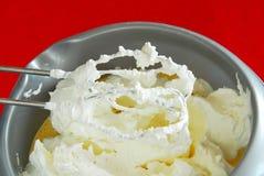 Mixer whisks with cream Stock Photo