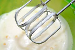 Mixer Whisks and Whipped Eggs in Bowl Stock Photo