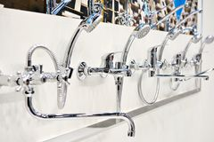 Mixers taps for shower in store. Mixers taps for shower in a hardware store Stock Image