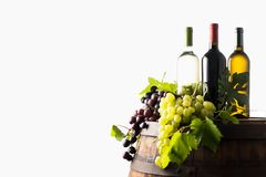 Mixes of bottle ow wine on barrel. With grape on white background royalty free stock photography