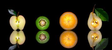 Mixfruit. Close up view of sliced piece of fruits on black back Royalty Free Stock Images