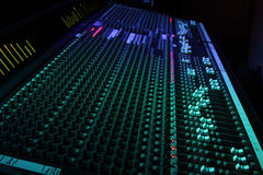 Mixing. 40ch Large format sound console with meter bridge and blue/green led lights Royalty Free Stock Images