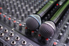 Mixing. Two microphones on a studio mixing board stock image