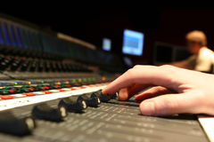 Mixing. Finger control on Fader 5 on Film Mixing console Royalty Free Stock Images