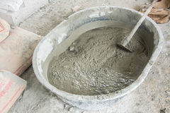 Mixing A Cement In Salver Royalty Free Stock Image